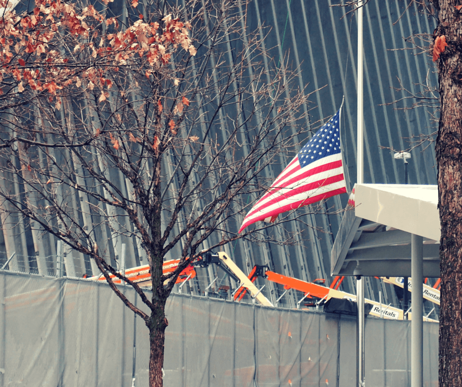 A flag flies near the museum entrance at the September 11 Memorial