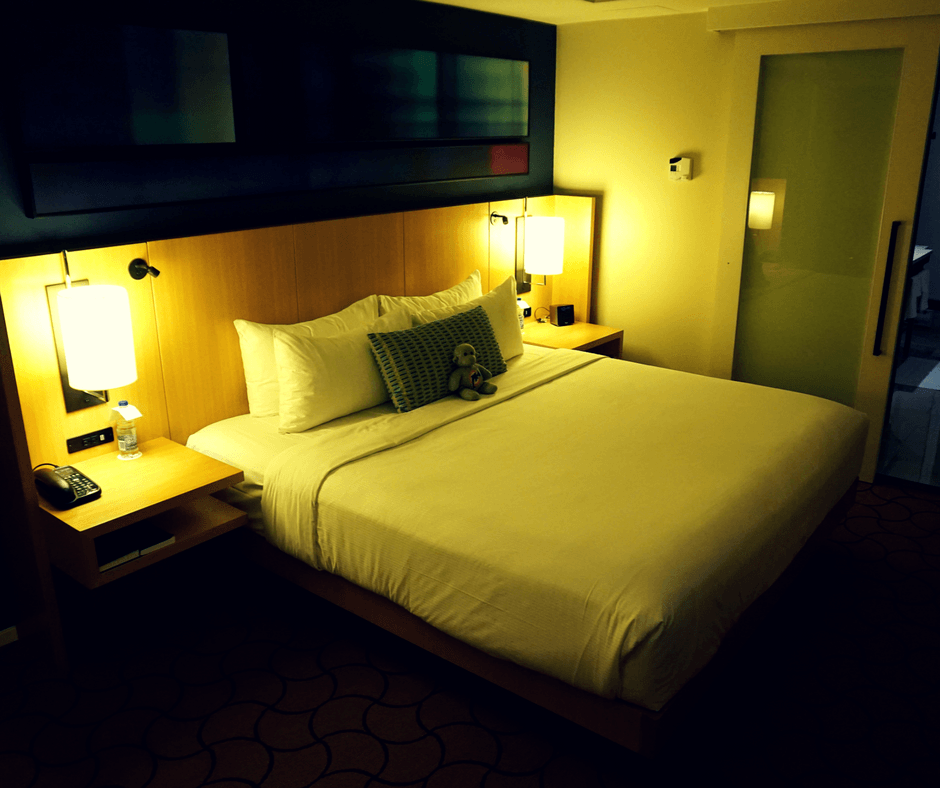 large king sized bed with fluffy pillows inside a room at the Delta Hotel Toronto
