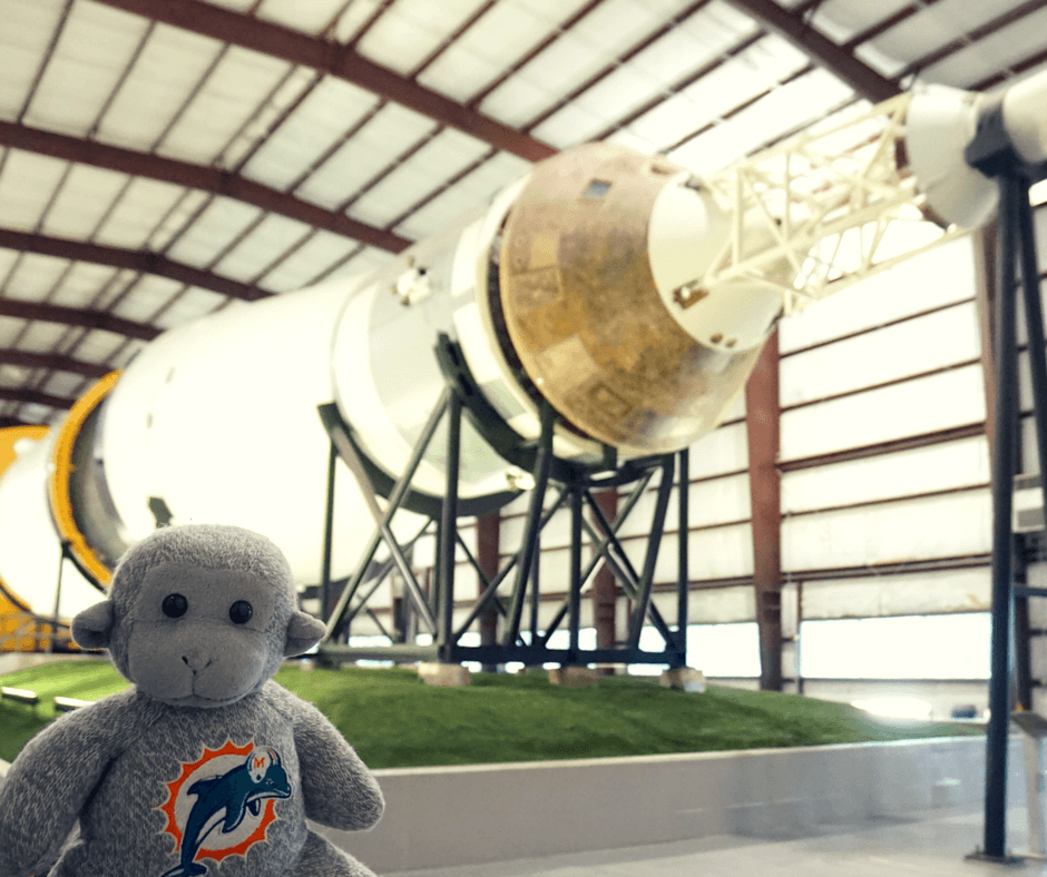 Buddy in front of the Saturn V rocket inside Space Center Houston