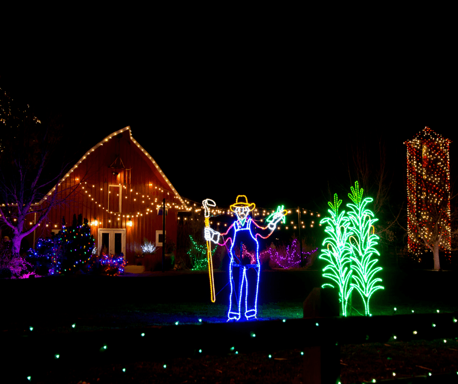 A scarecrow and house of lights at Chatfield Farms