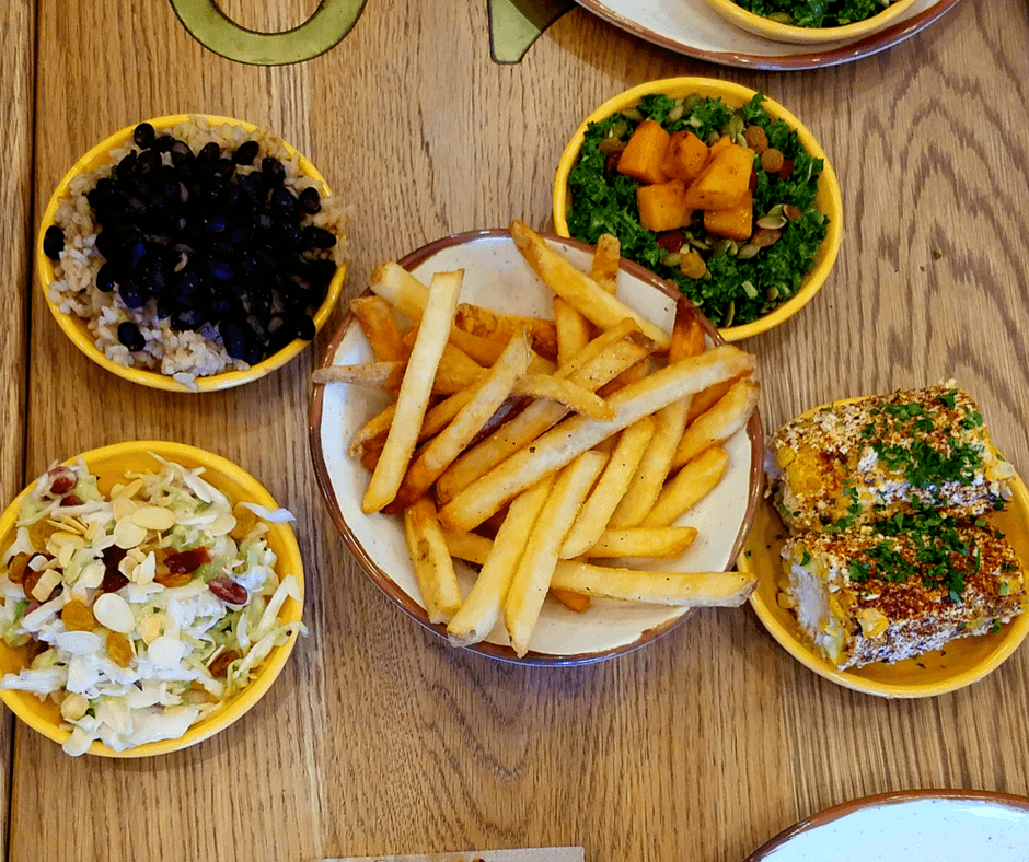 Spatch Peri-Peri Chicken sides of rice and beans, fries, coleslaw, corn on the cob, sweet and spicy kale