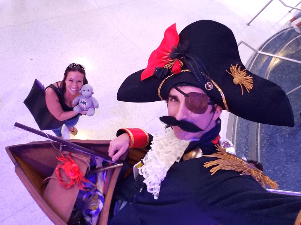 Selfie with a ship captain on stilts at Georgia Aquarium!