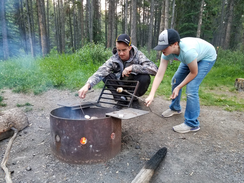 Cooking s'mores over the fire at Two Jack Lakeside Campground