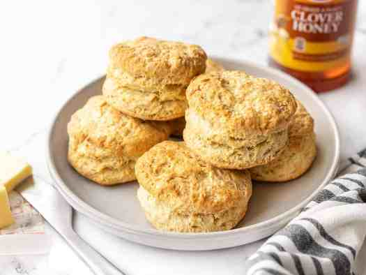 Side view of a plate full of butter biscuits