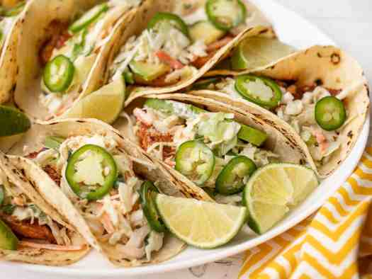 Side view of fish tacos on a platter