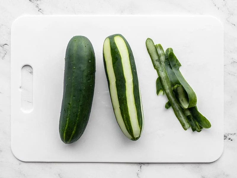 Two cucumbers, one half peeled