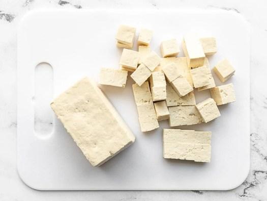 cubed tofu on a cutting board