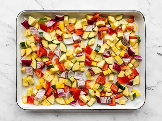 Diced vegetables on a baking sheet