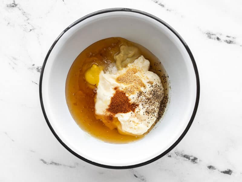 Honey mustard sauce ingredients in a bowl