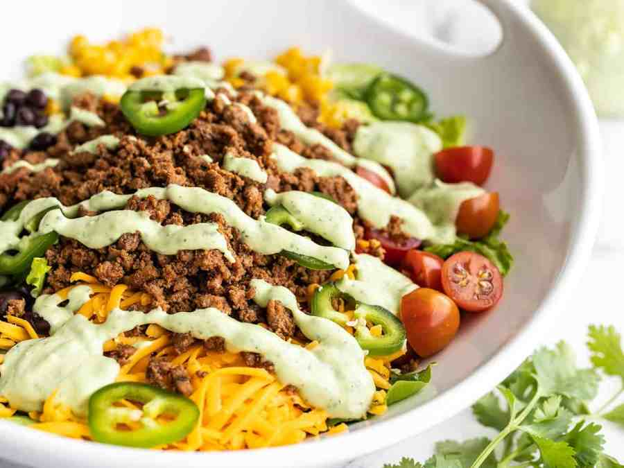 Close up side view of turkey taco salad in a serving bowl