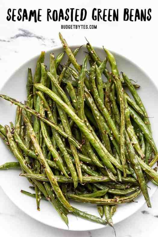 Overhead view of sesame roasted green beans, title text at the top