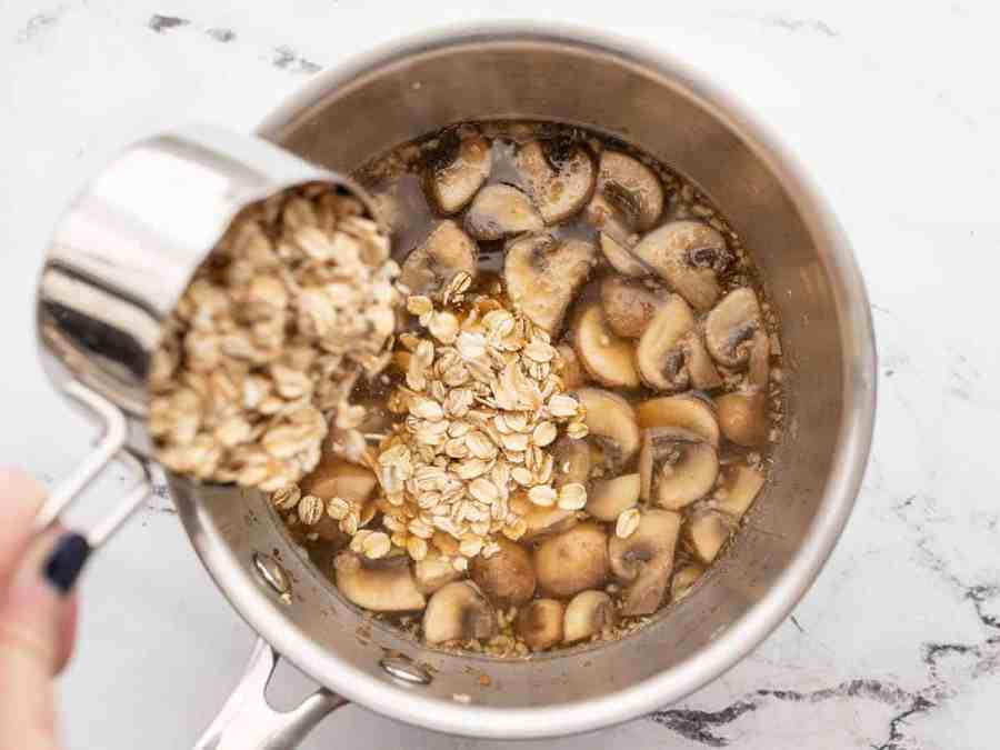 Oats being poured into the saucepot