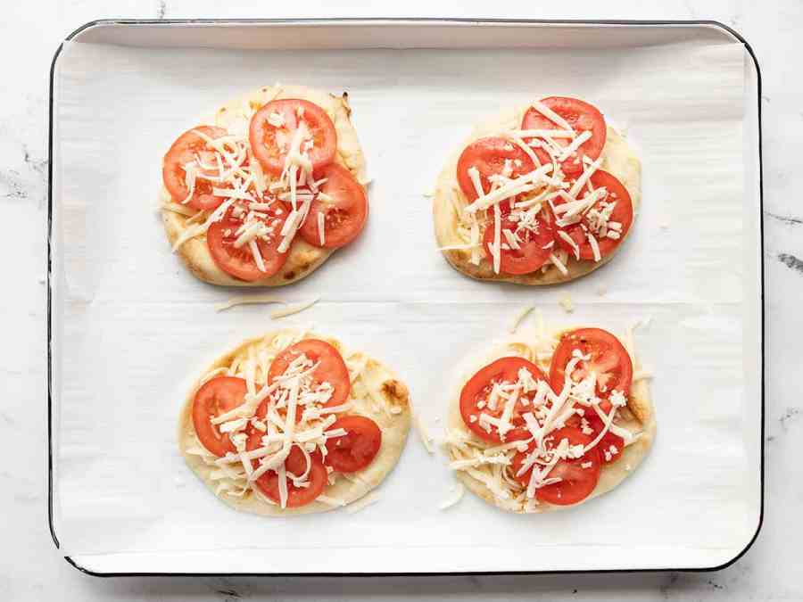 Topped pizzas on the baking sheet