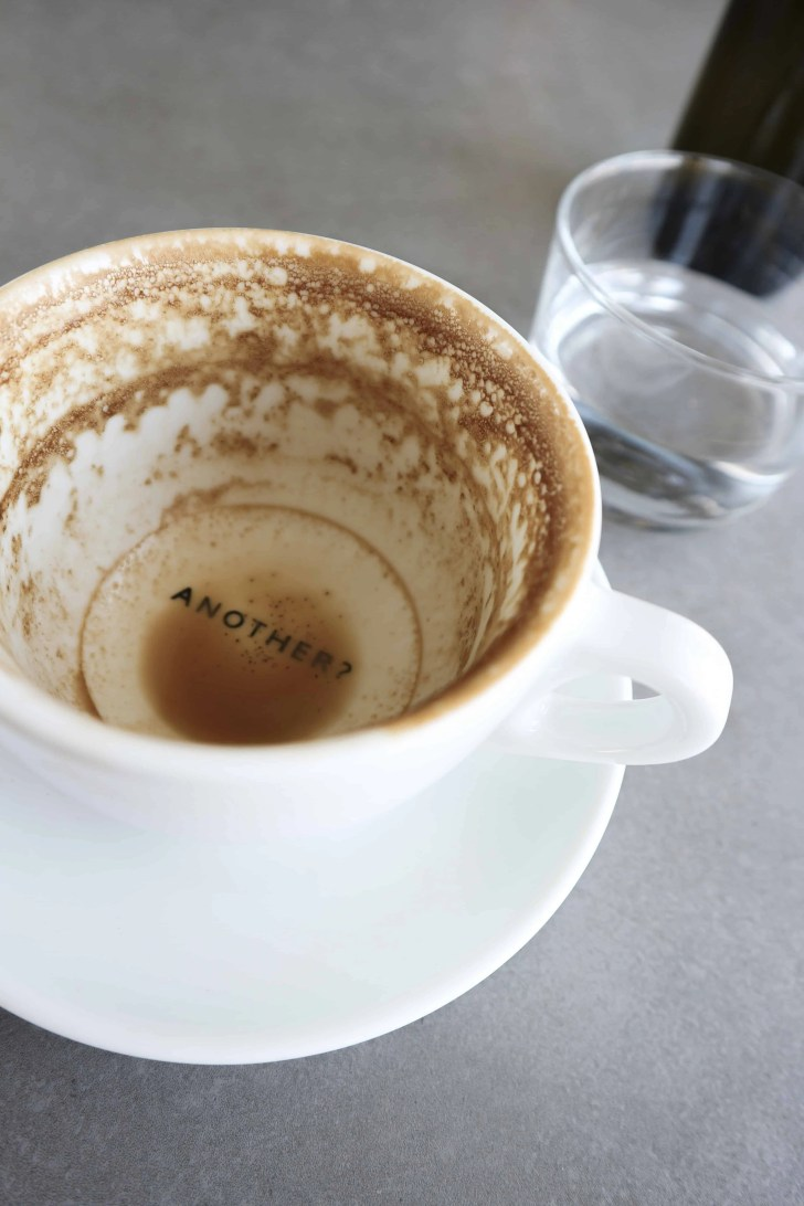 "empty coffee cup that says ""another?"""