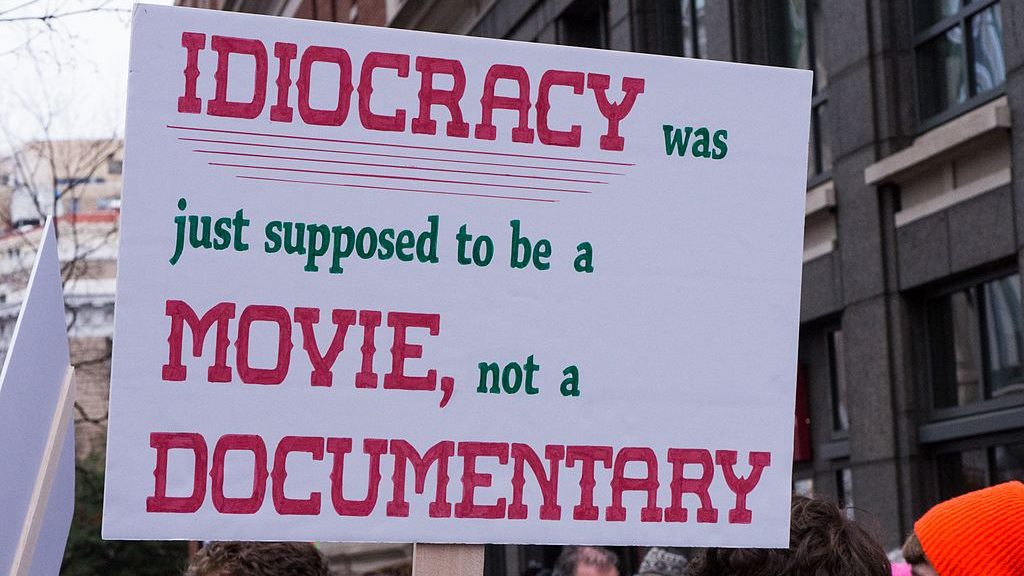 """Mielenosoituskyltti: """"Idiocracy was just supossed to be a movie, not a documentary."""