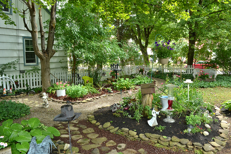 Too shady for grass, Hamburg yard is filled with gardens ... on Patio And Grass Garden Ideas id=56259