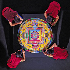 Tibetan Buddhist monks creating a mandala...