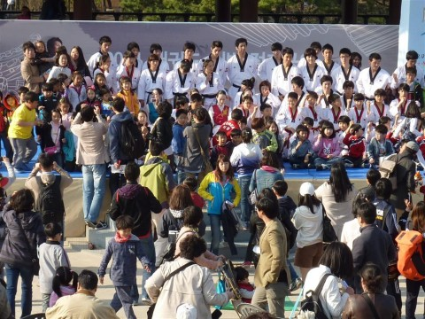 Everyone wants a souvenir shot with the taekwondo masters!