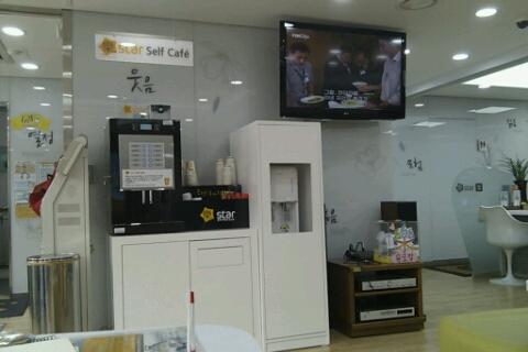 An espresso machine, water dispenser and a TV!
