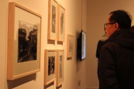 A visitor enjoying the photographs