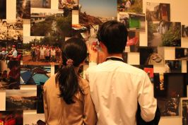 A couple looking at the photos on display