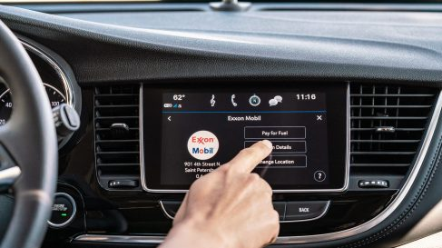 2020 Buick Encore Small Luxury SUV: driver interacting with the infotainment system