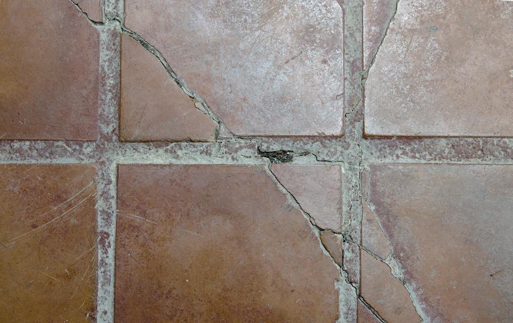 how to hide or repair cracked tiles in