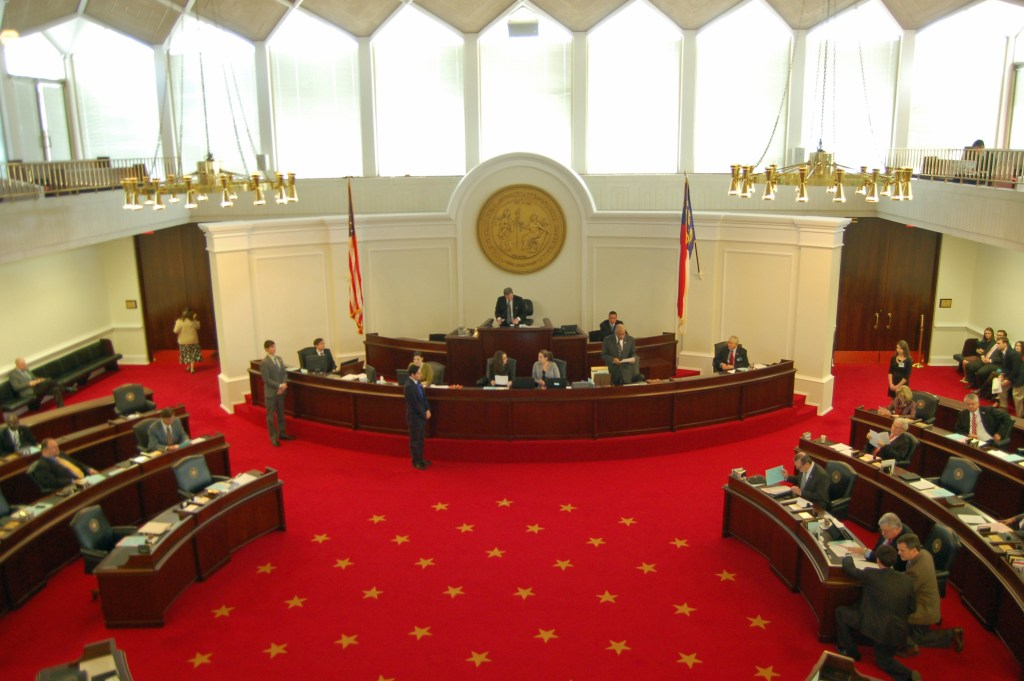 A sessions of the North Carolina state legislature debating a budget bill. In a True Representation government, the voice of the people would be present in legislative sessions.