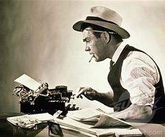 Guest Author Typing on a Typewriter