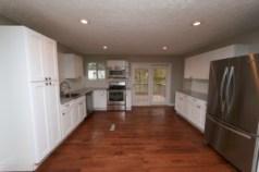 saman tasg white shaker kitchen cabinets granite counter tops