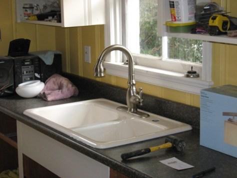 Kohler kitchen faucet in Kohler cast iron sink -- laundry room