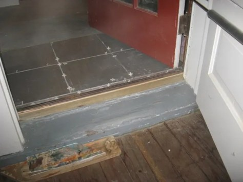 Installing a Tile Landing :: tile landing called for raising exterior threshold Pressure treated lumber used to elevate the threshold