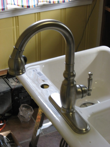 swivel head of kitchen faucet to balance while staging sink