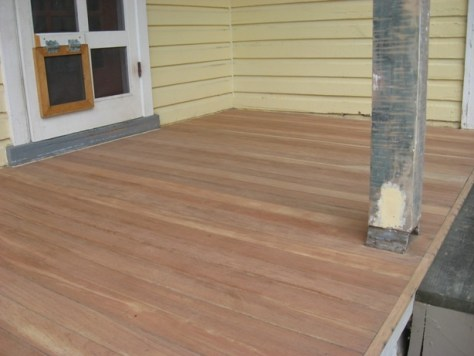 stripped and sanded red mahogany porch