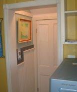 Evyn's art. Cut down basement door & salvaged lighting in hallway. Smoke detector out of frame.