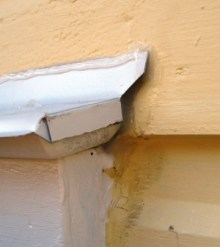Rough edge and unfinished caulk at completed cap