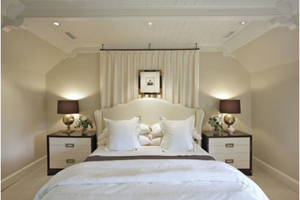 a solid panel wool drapery covers the window behind the bedframe