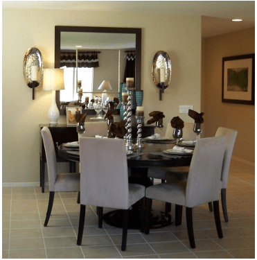 mirror in dining room doubles the view from the window and reflects setting