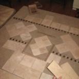 tile layouts for shower done on bedroom floor