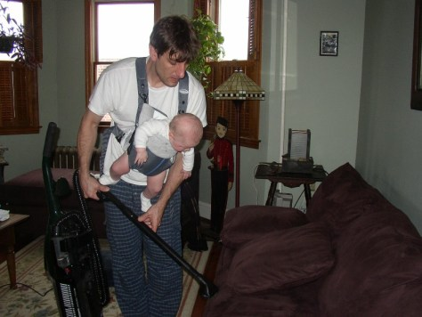 Vacuuming with Baby in Baby Carrier