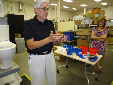 Gary Uhl of American Standard Holding Miso Debbie Drury in the Background
