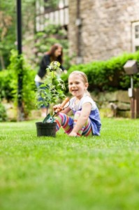 Little Girl with Potted Plant on Green Lawn image via Davey Tree