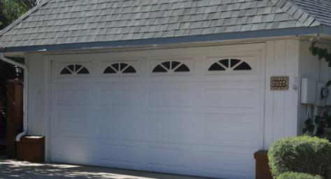 Garage Door White 16 panel Sunbursts image via A1 Garage Door Service
