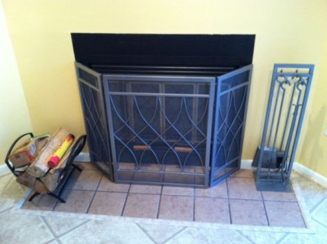 Wood Fireplace with Glass Doors Decorative Screen source :: Ryan McCracken
