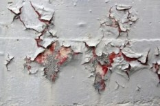 close up peeling-paint on concrete image via Justin Krutz