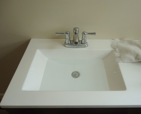 Chrome Faucet on a White Vanity Top