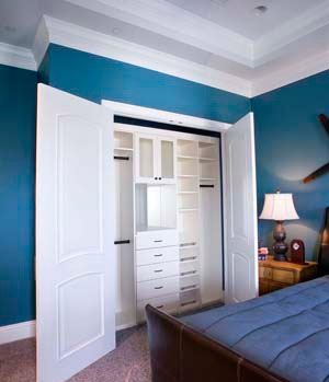 bedroom reach in closet blue french doors
