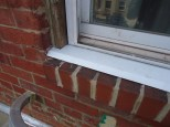Sill Slipped Under Window Frame Installed