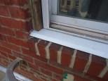 Sill Slipped Under Window Frame Installed