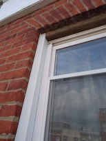Window Cap with Brick Bend Back-caulked Reinstalled
